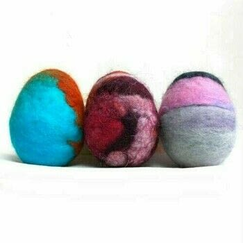 Learn how to make colorful wet felted Easter Eggs with wool roving .  Free tutorial with pictures on how to make a misc in under 60 minutes by felting with felting wool, plastic easter eggs, and panty hose. Inspired by easter eggs and easter. How To posted by FiberArtsy.  in the Other section Difficulty: Simple. Cost: Cheap. Steps: 9