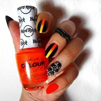 Fiery and Fierce .  Free tutorial with pictures on how to paint a nail painting in under 120 minutes using glitter, studs, and spikes. How To posted by Lacquered Lawyer.  in the Beauty section Difficulty: Simple. Cost: Cheap. Steps: 5