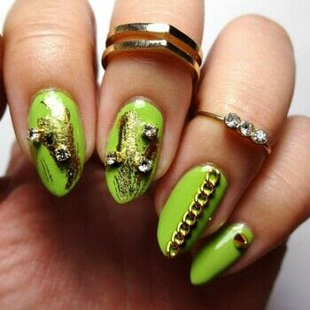 These nail are ready to rock .  Free tutorial with pictures on how to paint a nail painting in under 60 minutes using rhinestones, gold chain, and krazy glue. How To posted by Lacquered Lawyer.  in the Beauty section Difficulty: Easy. Cost: Cheap. Steps: 3