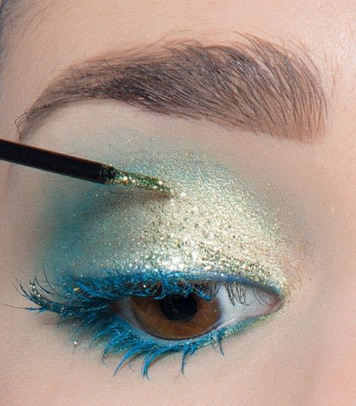 How to create a blue eye makeup look. Showgirl Transformation - Step 13