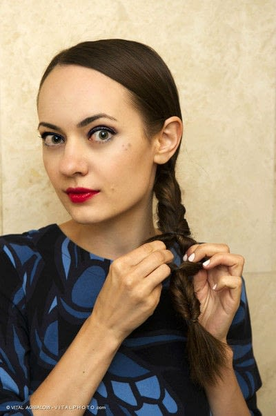 How to style a ponytail. Twisted Ponytail - Step 8