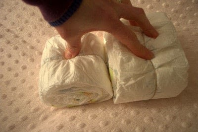 How to make a diaper cakes. Sleeping Baby Diaper Cake Tutorial - Step 4