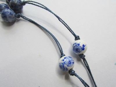 How to make a paper bead necklace. Temple Tassel - Step 8
