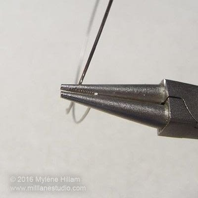 How to make jewelry. Turning Loops On Memory Wire - Step 2