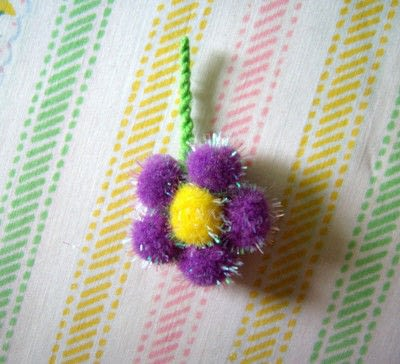 How to make a clip-on earring. Daisy Pom Pom Earrings - Step 7