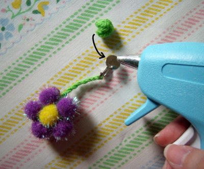 How to make a clip-on earring. Daisy Pom Pom Earrings - Step 8