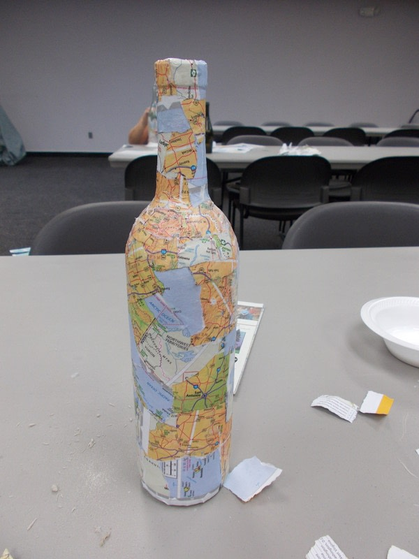 Decoupage map collage wine bottle how to make a home for How to remove bottom of glass bottle