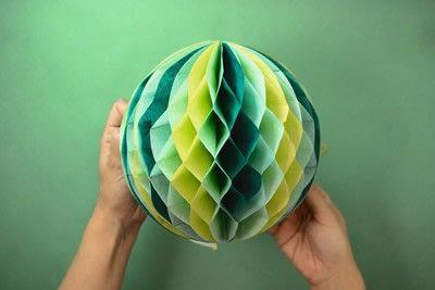How to make a pom pom decoration. Honeycomb Pom Pom - Step 8