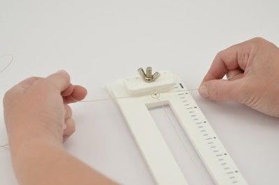 How to make a beaded bracelet. Shamballa Style Bracelet With The Beadalon Tying Station - Step 7