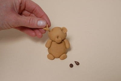 How to decorate a novelty cake. Sugarpaste Teddy  - Step 5