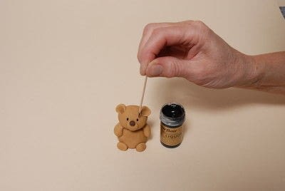 How to decorate a novelty cake. Sugarpaste Teddy  - Step 6