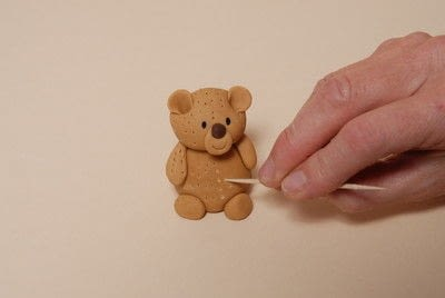 How to decorate a novelty cake. Sugarpaste Teddy  - Step 7