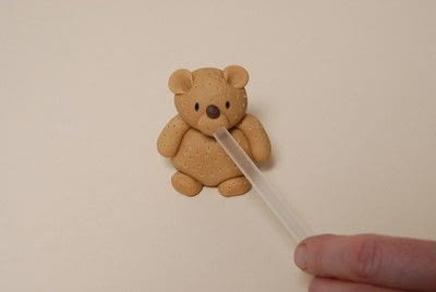 How to decorate a novelty cake. Sugarpaste Teddy  - Step 8