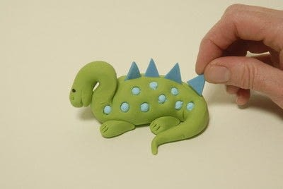 How to decorate a novelty cake. Blue And Green Dinosaur  - Step 7