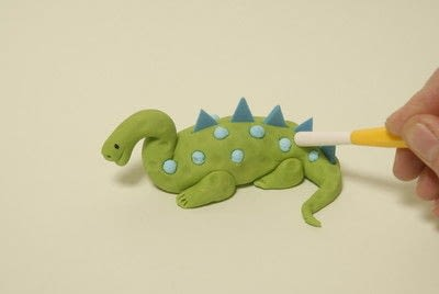 How to decorate a novelty cake. Blue And Green Dinosaur  - Step 8