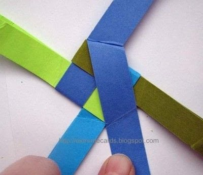 How to fold an origami shape. Woven Paper Discs - Step 4