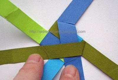 How to fold an origami shape. Woven Paper Discs - Step 5