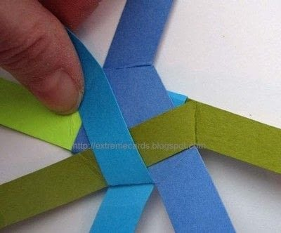 How to fold an origami shape. Woven Paper Discs - Step 6