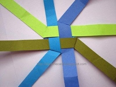How to fold an origami shape. Woven Paper Discs - Step 8
