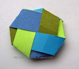 How to fold an origami shape. Woven Paper Discs - Step 10