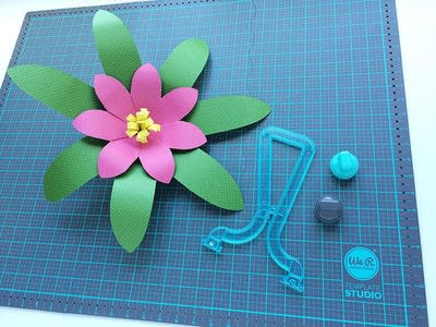 How to make a paper flower. Giant Paper Flowers For A Moana Party - Step 7