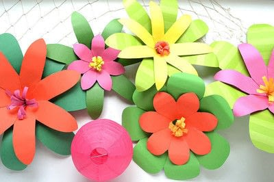 How to make paper flowers with construction paper step by step how to make a paper flower giant paper flowers for a moana party step mightylinksfo