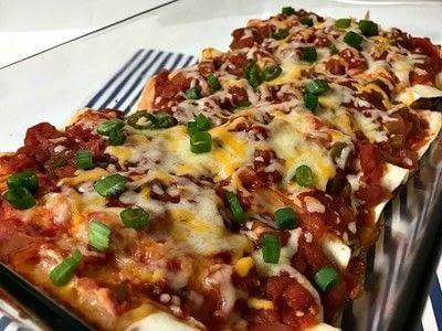 How to cook a chicken dish. Cheesy Chicken Enchiladas  - Step 5