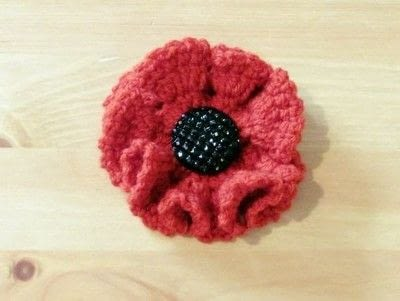 How to stitch a knit or crochet flower brooch. How To Crochet A Poppy To Sell For Charity - Step 6