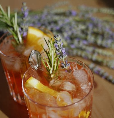 How to mix a champagne cocktail. Summer Punch With Bourbon, Bubbles, And Lavender - Step 3