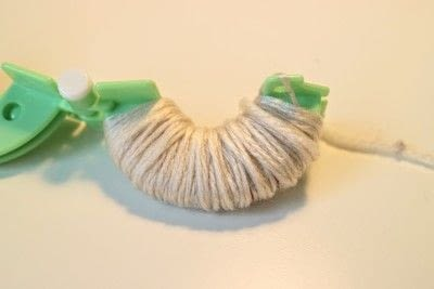 How to make a pom poms. Princess Leia Pom Pom - Step 3