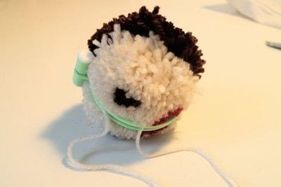 How to make a pom poms. Princess Leia Pom Pom - Step 10