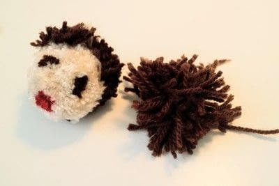 How to make a pom poms. Princess Leia Pom Pom - Step 18