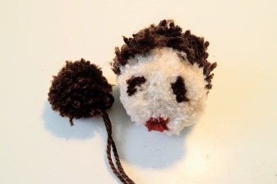 How to make a pom poms. Princess Leia Pom Pom - Step 19