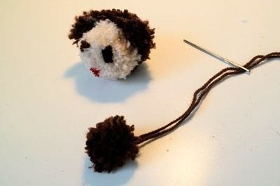 How to make a pom poms. Princess Leia Pom Pom - Step 20