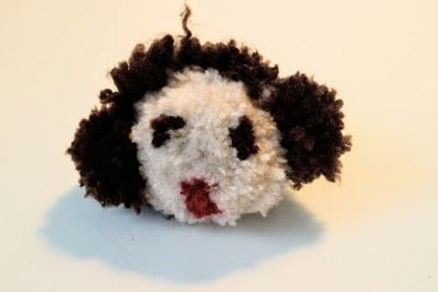 How to make a pom poms. Princess Leia Pom Pom - Step 21