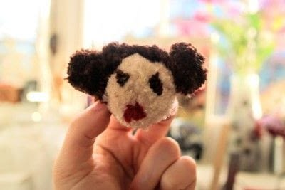 How to make a pom poms. Princess Leia Pom Pom - Step 24