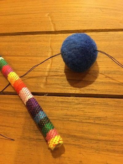 How to make a pom pom necklace. Pom Pom Cord Necklace - Step 3