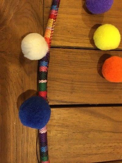 How to make a pom pom necklace. Pom Pom Cord Necklace - Step 5