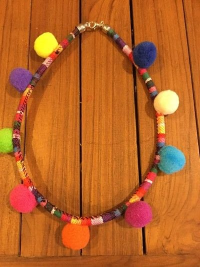 How to make a pom pom necklace. Pom Pom Cord Necklace - Step 9