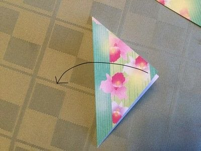 How to fold an origami shape. Origami Compass Star - Step 1