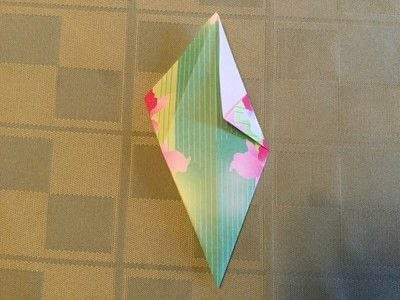 How to fold an origami shape. Origami Compass Star - Step 6