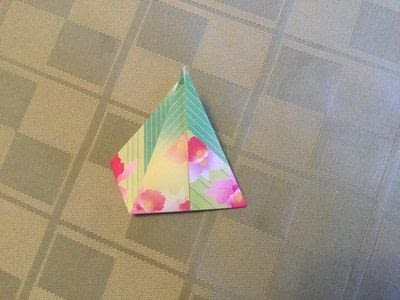 How to fold an origami shape. Origami Compass Star - Step 8