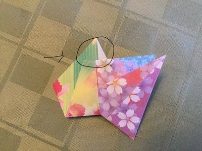How to fold an origami shape. Origami Compass Star - Step 15