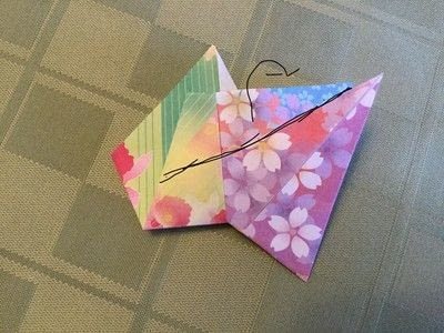How to fold an origami shape. Origami Compass Star - Step 16