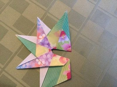 How to fold an origami shape. Origami Compass Star - Step 19