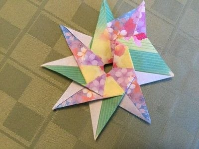 How to fold an origami shape. Origami Compass Star - Step 20