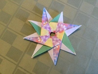 How to fold an origami shape. Origami Compass Star - Step 21