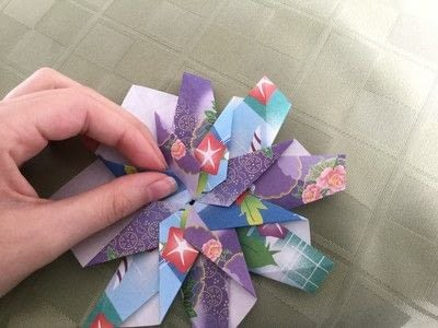 How to make an origami flower. Origami Aster - Step 22