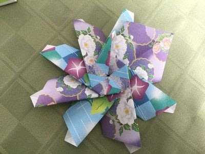 How to make an origami flower. Origami Aster - Step 23