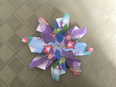 How to make an origami flower. Origami Aster - Step 25